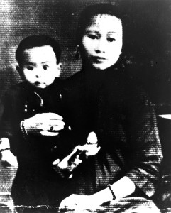 Sewing-Woman-with-first-born-son,-ca-1940,-China